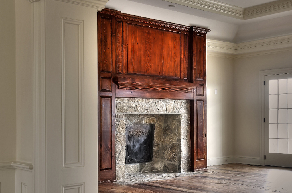Gorgeous and grand woodwork framing stone fireplace